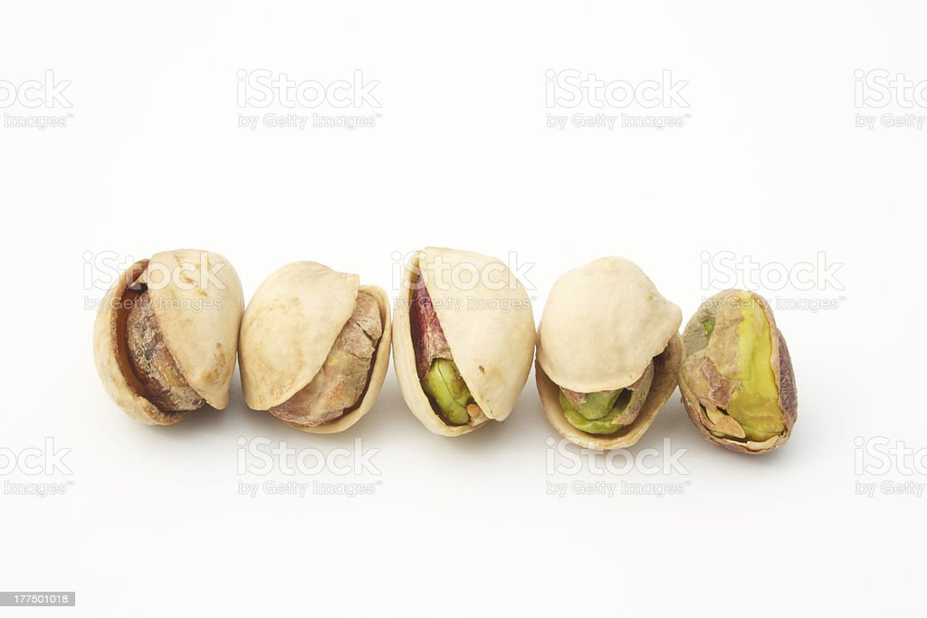 pistachio nut in a line peeled shell royalty-free stock photo