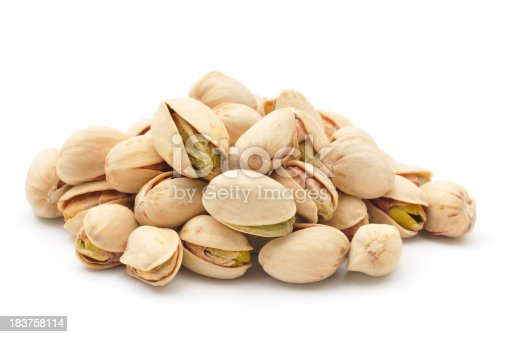 A small pile of Pistachio Nuts isolated on a white background.