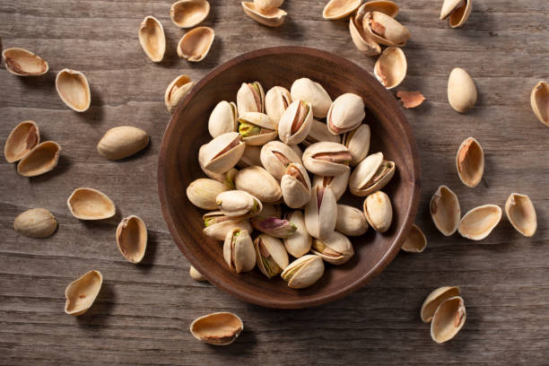 Pistachio nuts. Rustic style stock photo