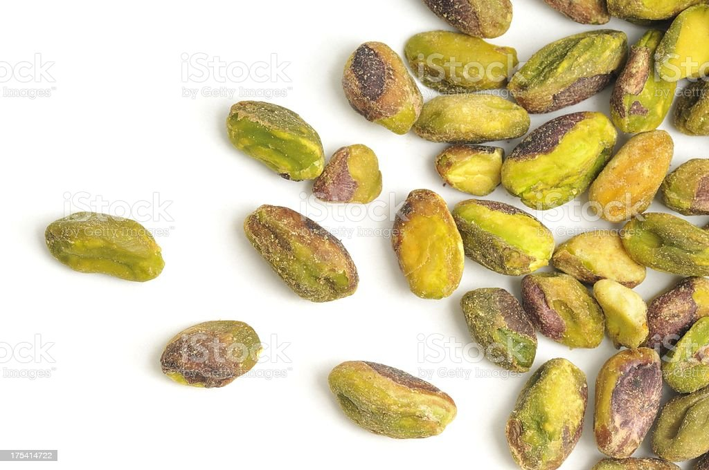 Pistachio Nuts shelled and scattered stock photo
