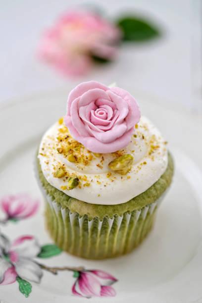 Pistachio Rose Cupcake stock photo