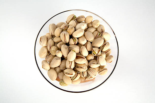 pistachios in a bowl stock photo