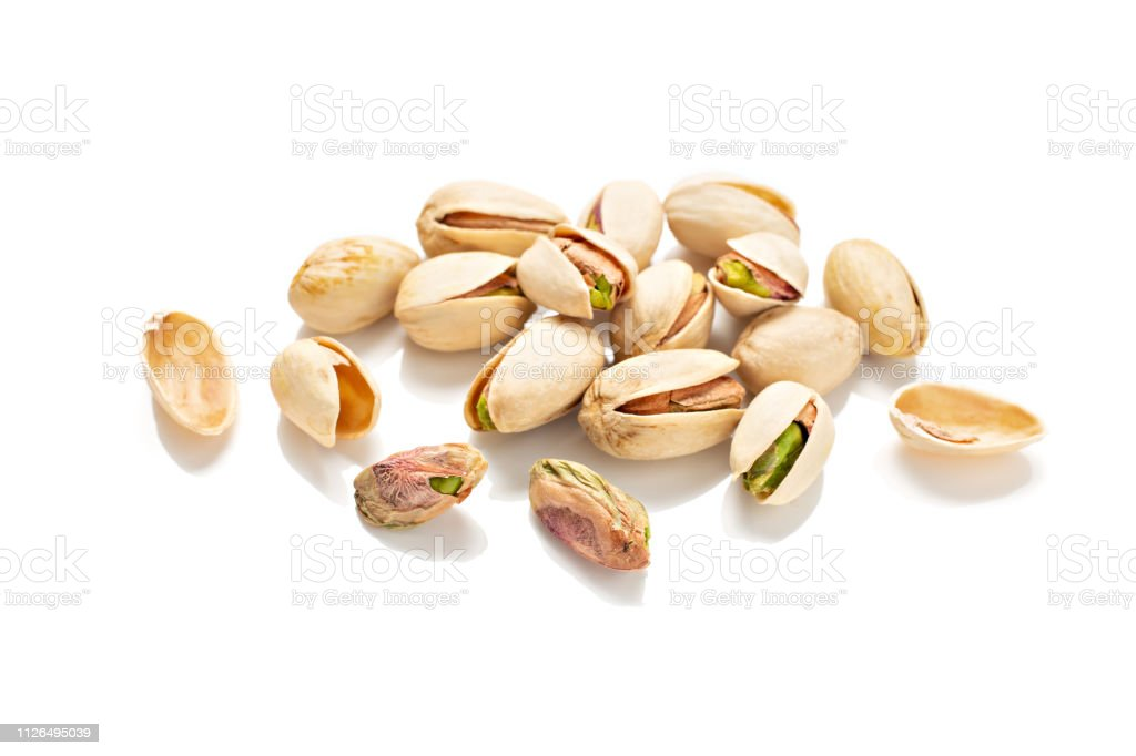 Pistachios isolated on a white background stock photo
