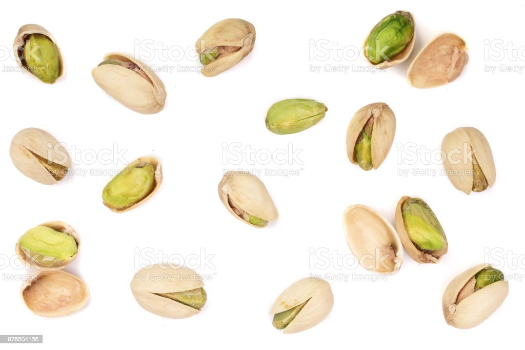 Pistachios isolated on white background, top view. Flat lay pattern stock photo