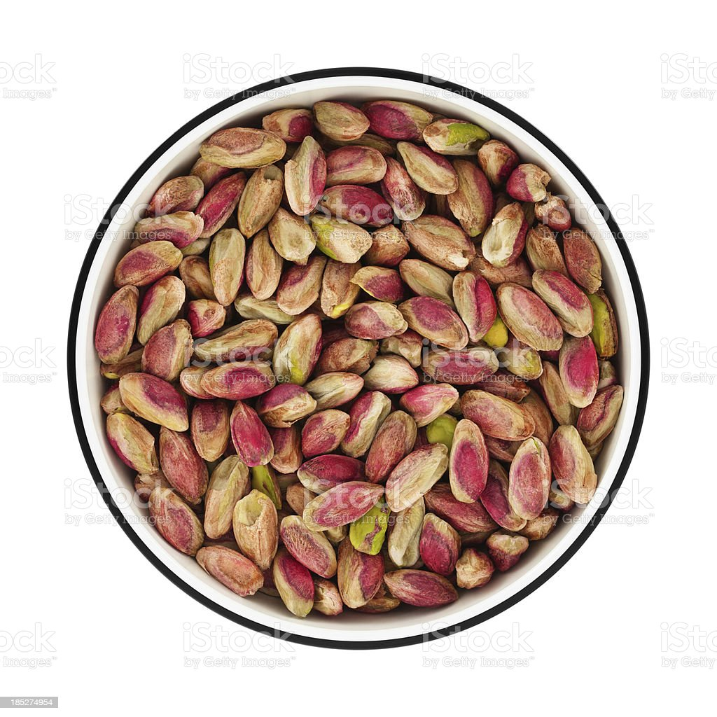 Pistachios on a bowl from directly above stock photo