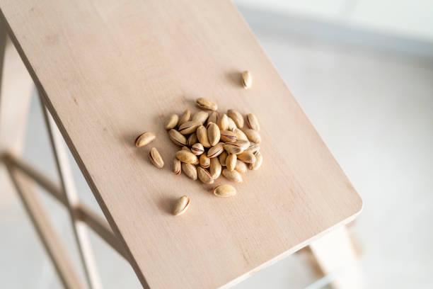 pistachios on wooden table macro view stock photo