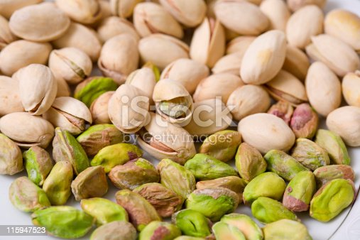 Shelled and unshelled roasted pistachios.