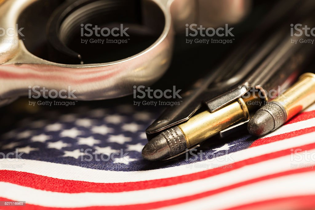 Pistol and Bullets with American Flag stock photo