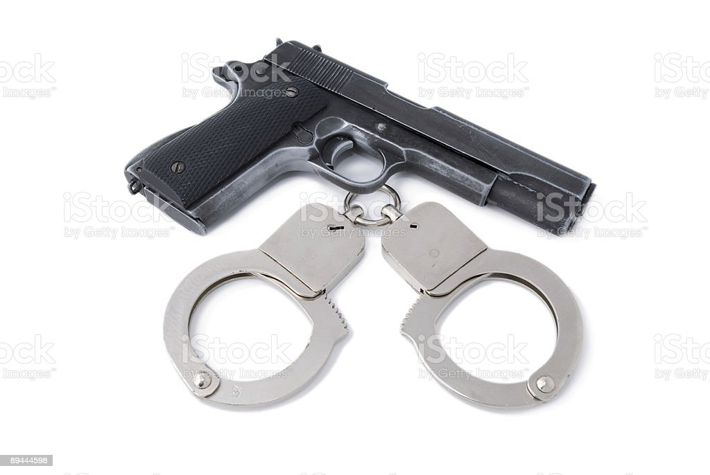 pistol and handcuff royalty-free stock photo