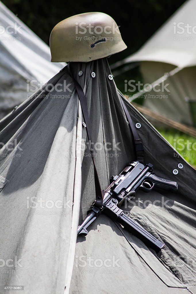 Pistol and Helmet Hanging on a Tent stock photo