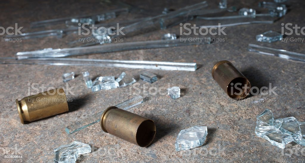 Pistol brass and glass stock photo