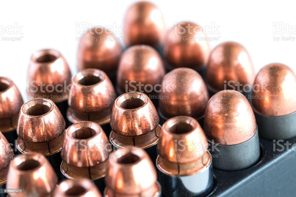 .45 Pistol bullets in a cartridge holder. stock photo