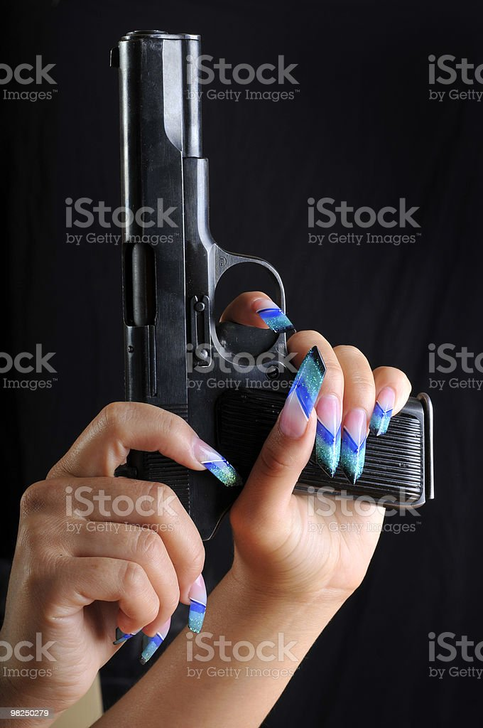 Pistol in hands royalty-free stock photo