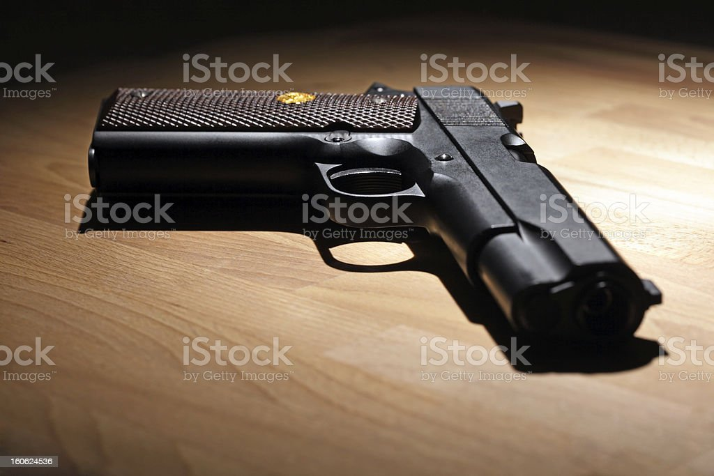 Pistol on the table royalty-free stock photo
