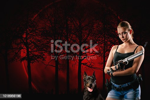 istock Pistol shooting isolated on red forest background. Sportsman with a gun. Sport pistol shooting. 1018956196