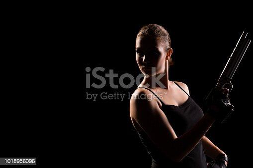 istock Pistol shooting on black background. Sportsman with a gun. Sport pistol shooting. 1018956096