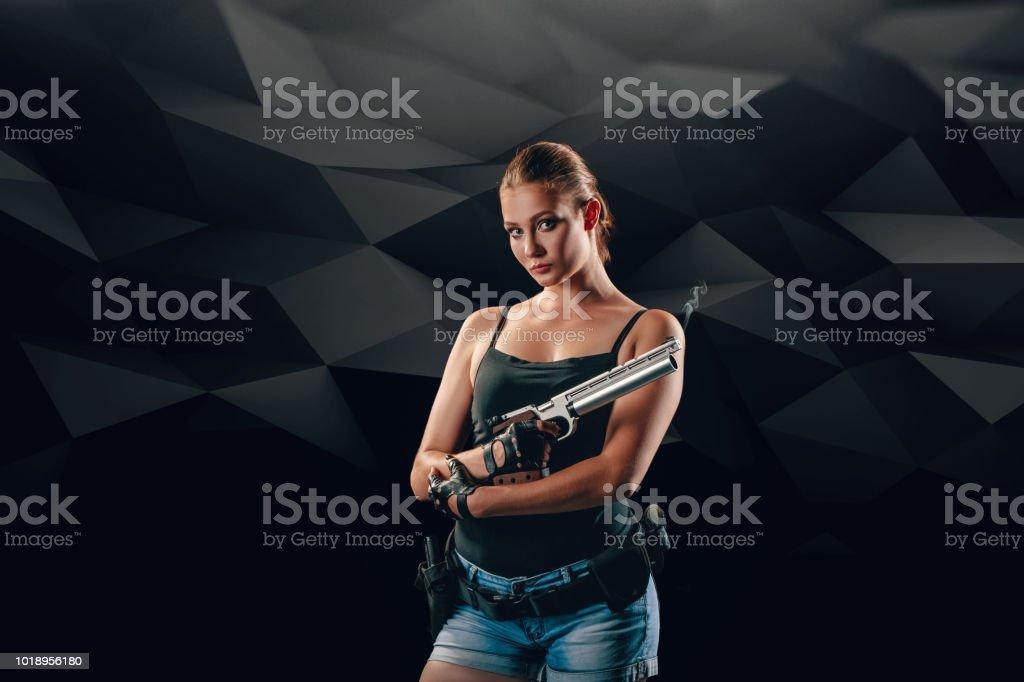 Pistol shooting on black background. Sportsman with a gun. Sport pistol shooting. stock photo