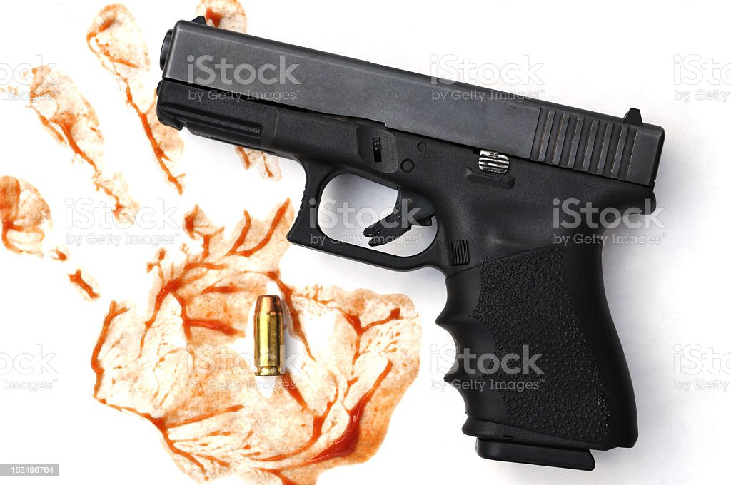 Pistol with a bloody hand print royalty-free stock photo