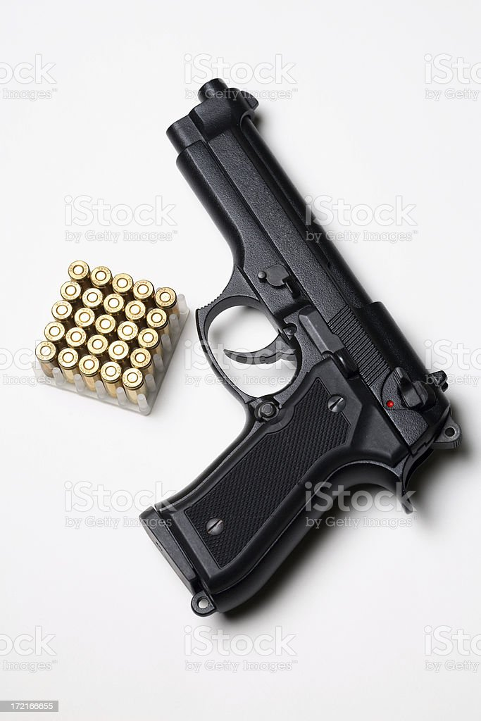 Pistol with bullets royalty-free stock photo