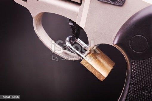 istock pistol with lock 849316190