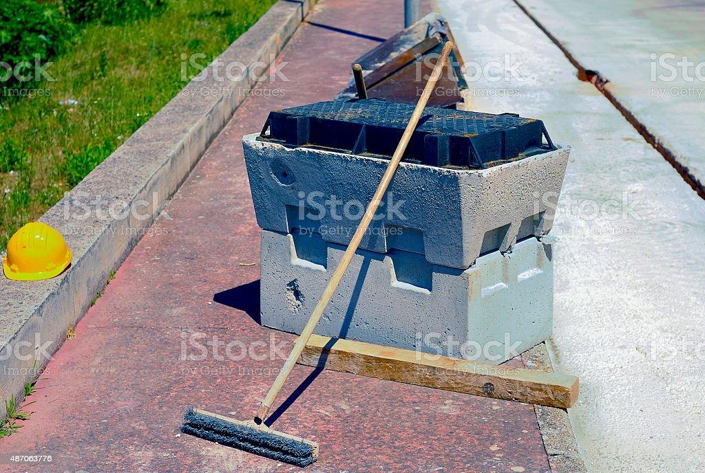 pit block precast concrete, helmet and scrubbing brush stock photo