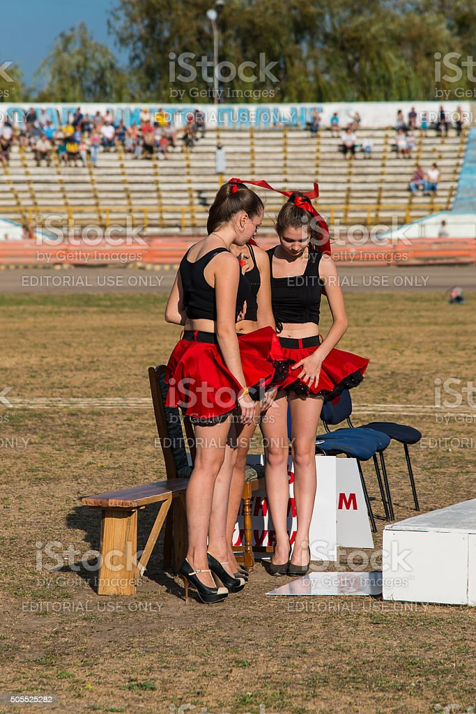 Pit lane girls getting ready for a competition stock photo
