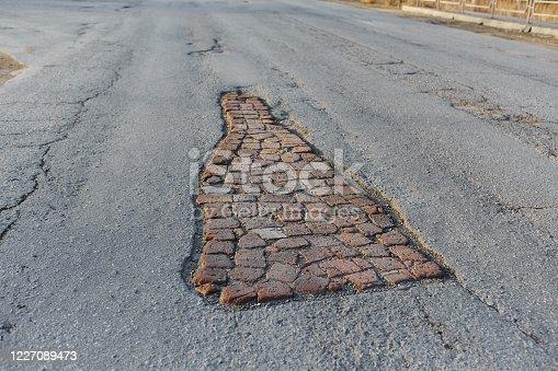 istock Pit road, laid old brick. Life hack. 1227089473