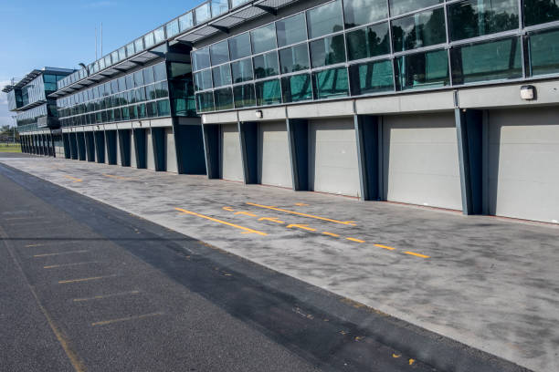 Pit Stop in the Race Track with Yellow Lines in Albert Park Australia racing track and pit stop with yellow lines in Albert Park, Melbourne, Australia paddock stock pictures, royalty-free photos & images