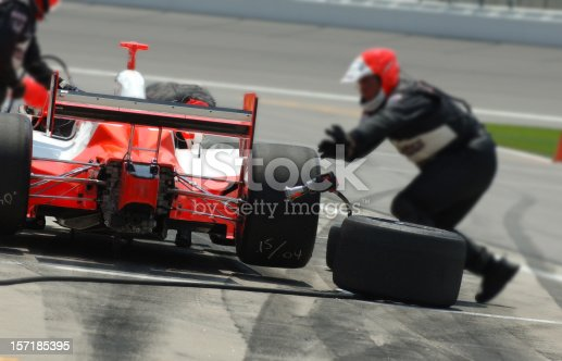 Tires are replaced rapidly on a pitstop during the race.