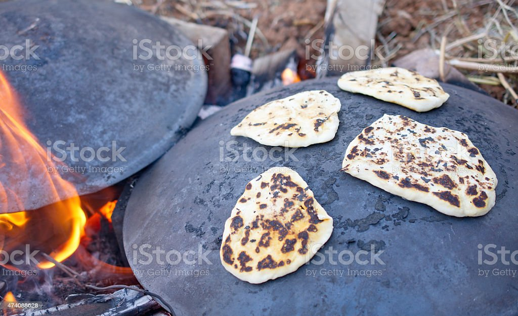 Pita bread baking on a Saj or Tava stock photo