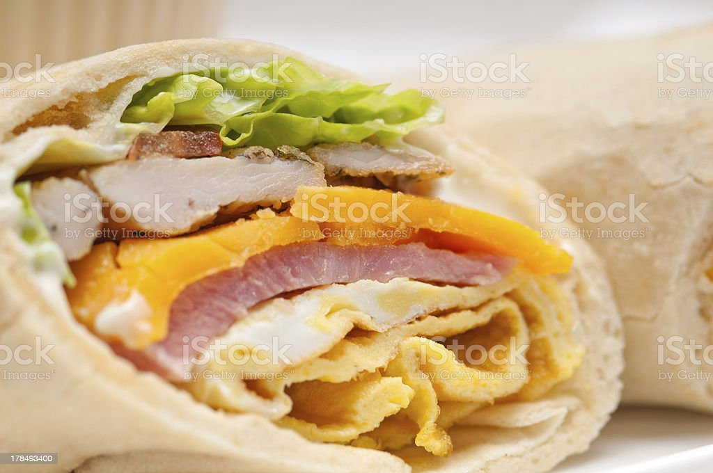 pita bread roll sandwich with cheese, steak and lettuce stock photo