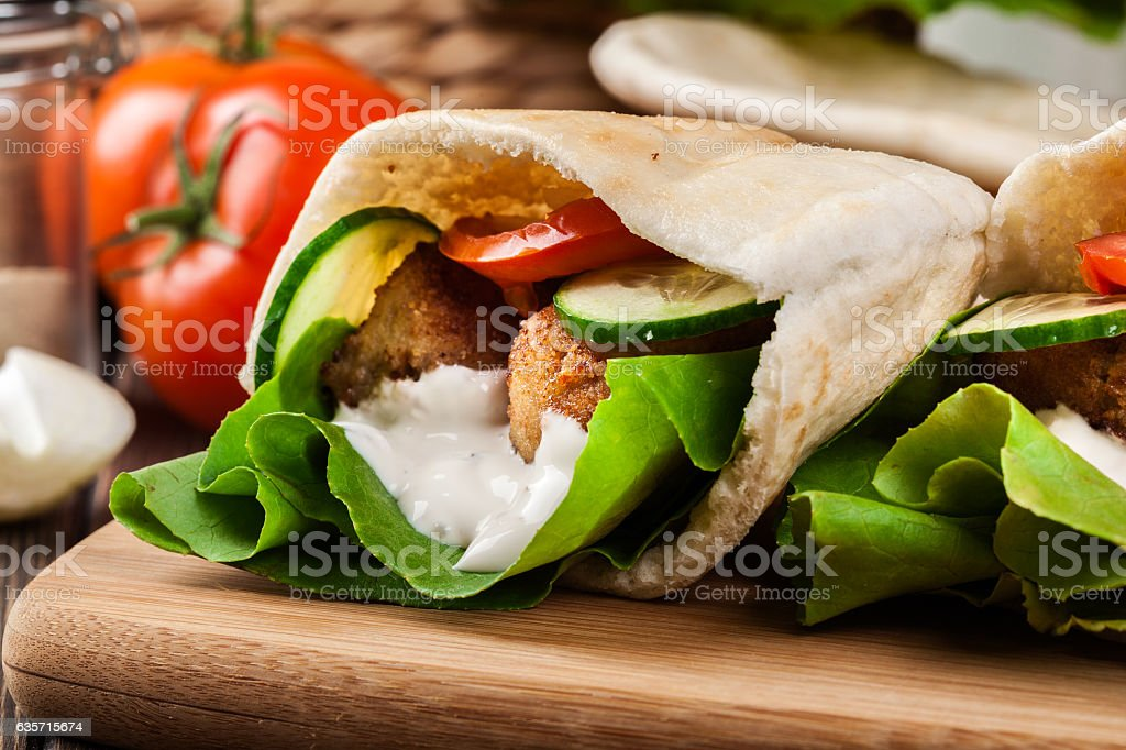 Pita bread with falafel and fresh vegetables royalty-free stock photo