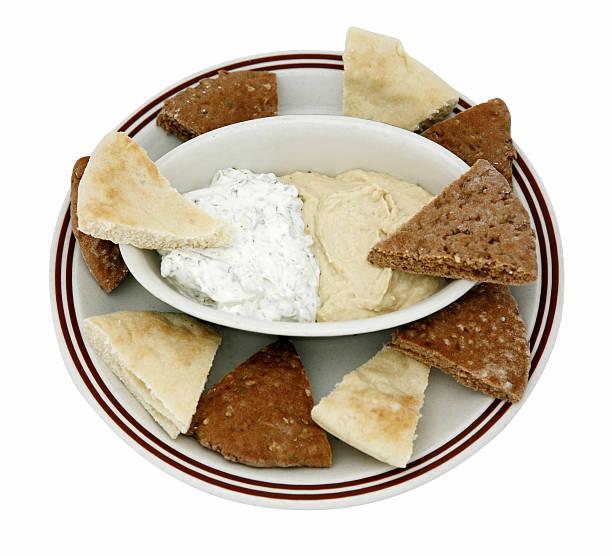 Pita Bread with hummus and tzatziki stock photo