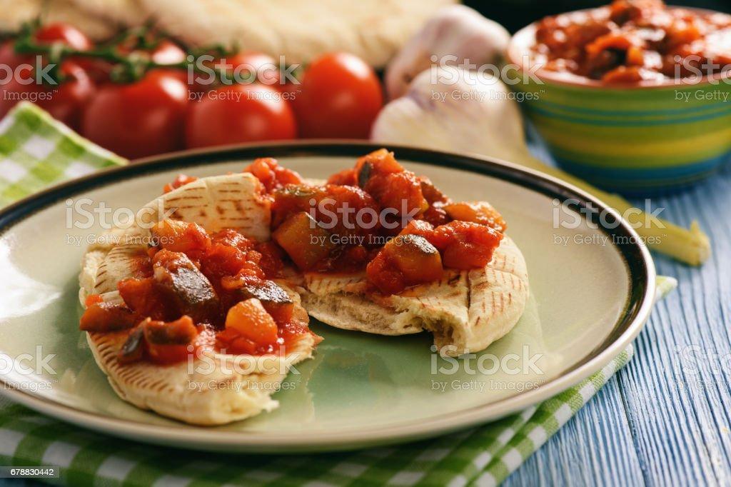 Pita bread with vegetable spread- mediterranean kitchen style. royalty-free stock photo