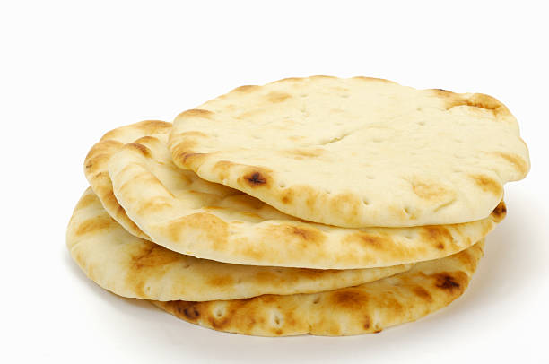 Pita Pita bread on white.  naan bread stock pictures, royalty-free photos & images