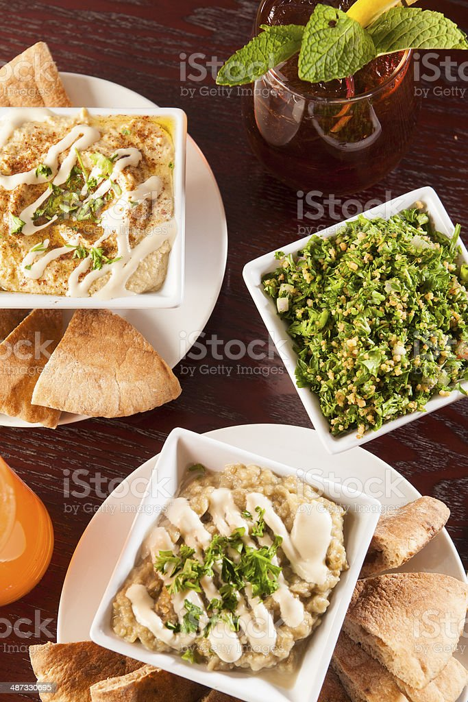 Pitas with hummus and baba ghanoush and Tabouleh stock photo