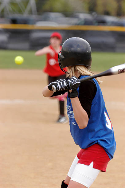 pitch on the way - softball stock photos and pictures