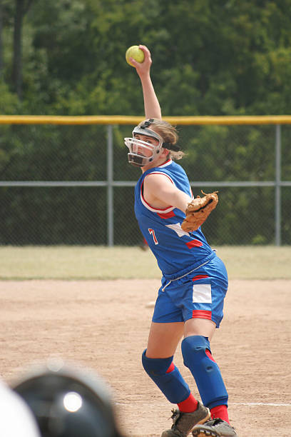 pitch! - softball stock photos and pictures