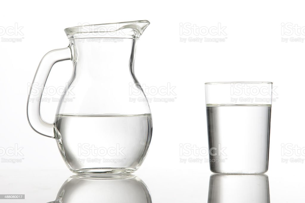 Pitcher and glass cup with water stock photo