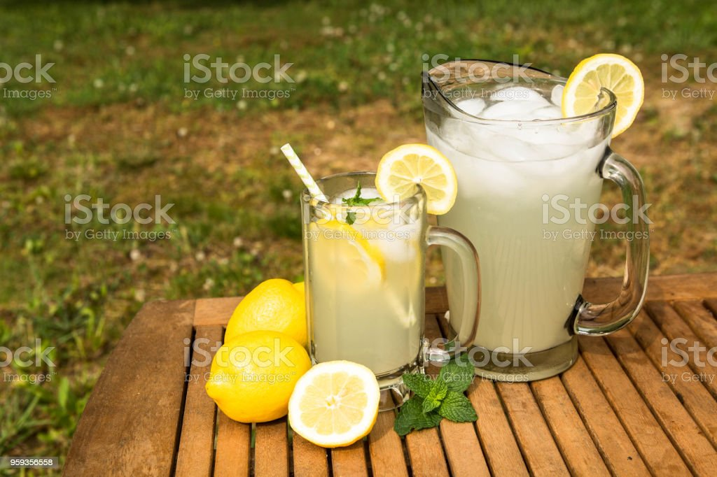 Pitcher and Glass of Lemonade Outside stock photo