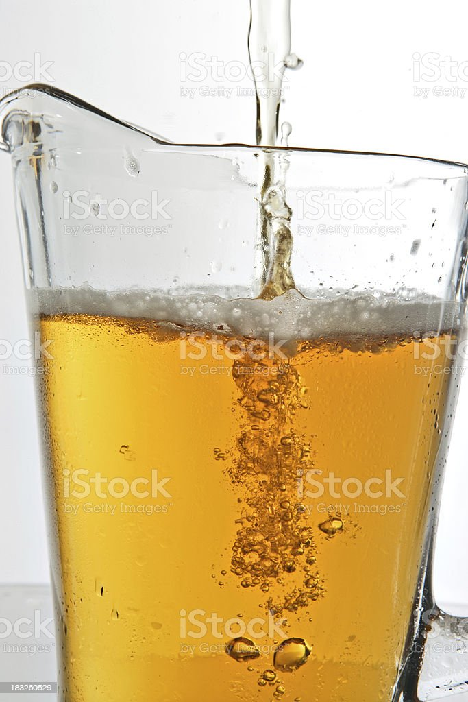 Pitcher Being Filled With Beer stock photo
