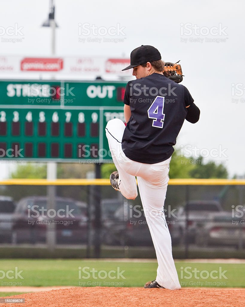 A pitcher getting ready to throw the ball on the field stock photo