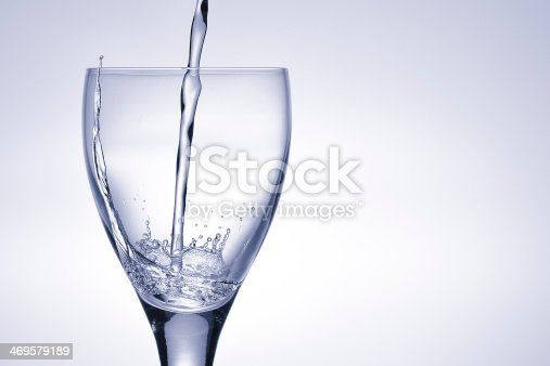 629189244 istock photo Pitcher pours water into a glass 469579189