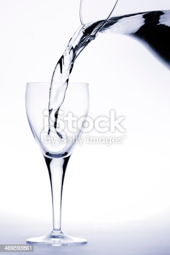 629189244istockphoto Pitcher pours water into a glass 469593861