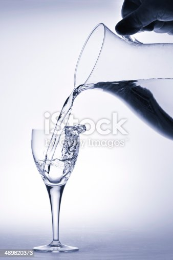 629189244 istock photo Pitcher pours water into a glass 469820373