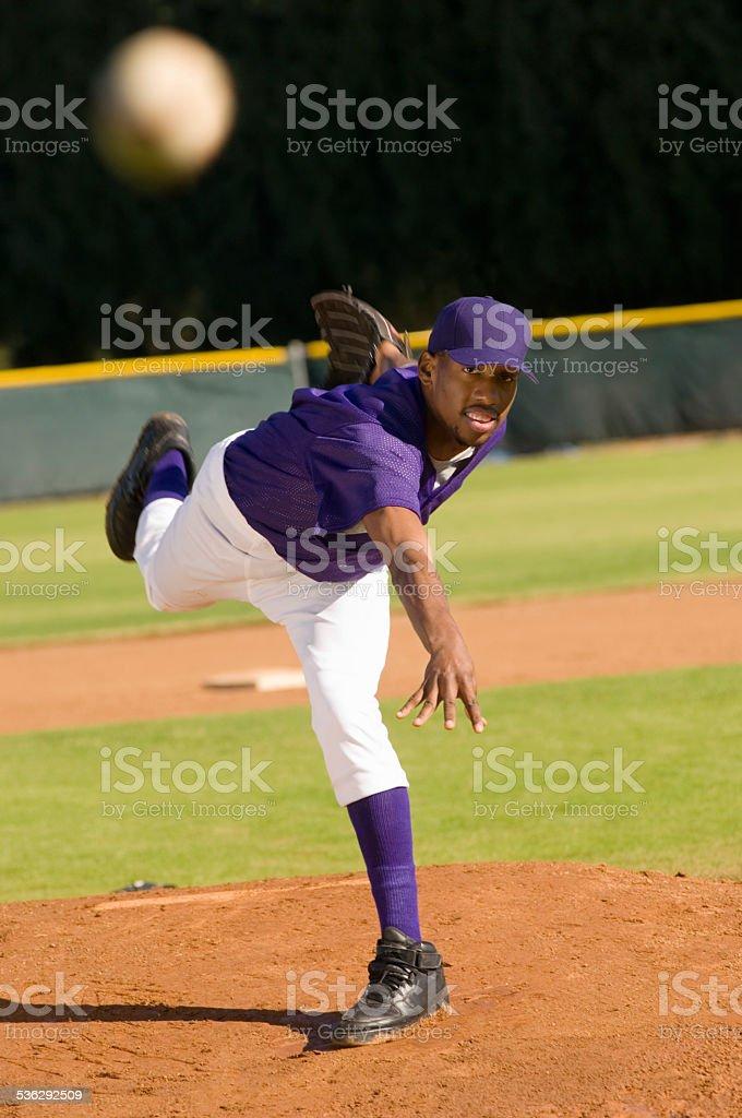 Pitcher Throwing Baseball Towards Batter stock photo