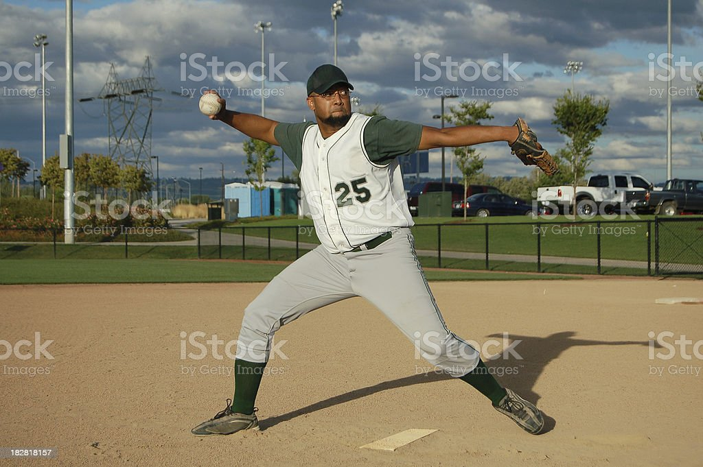 Pitcher Throws Ball stock photo