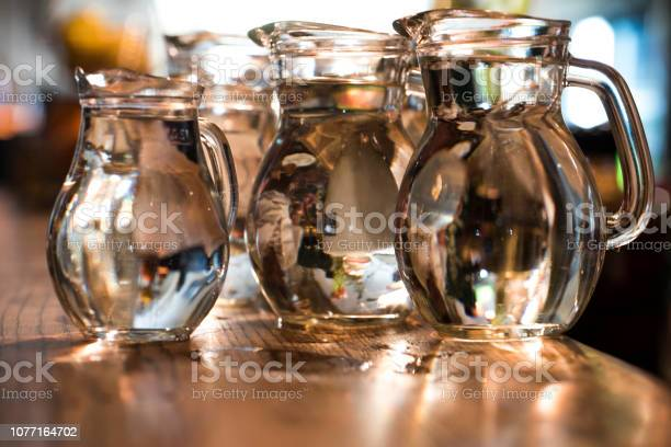 Pitchers full of water on a bar counter picture id1077164702?b=1&k=6&m=1077164702&s=612x612&h=pxqnw0fhxxcheyhhdhbhahe19wtnl3q8v03jrjw35ey=