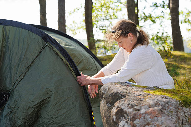 Pitching a tent stock photo