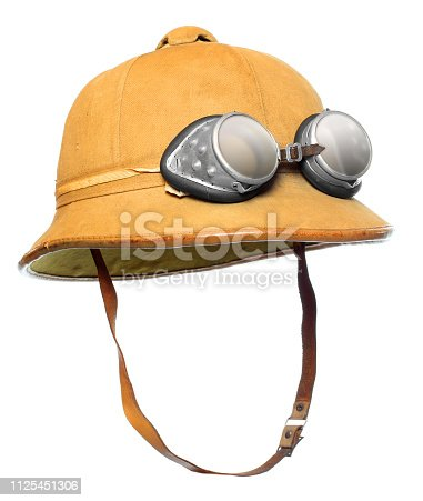 istock Pith helmet with motorcycle goggles. Protective wear for tropical destination. 1125451306